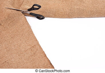 Scissors cutting sackcloth material