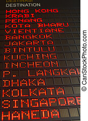 airport departures board that shows asian destinations.