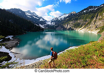 Hiker on the Blanca Lake - Male hiker on the Blanca Lake...