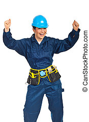 Successful constructor worker woman raising arms and...
