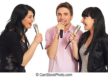 Happy friends singing at karaoke party - Happy three friends...