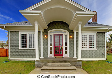 Front shot of cute grey house with pink door. - Small cute...