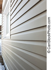 Wall finished in vinyl siding - Wall of the house, finished...