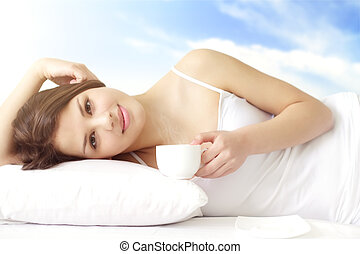 Morning cup of coffee - Girl with cup of coffee in bed