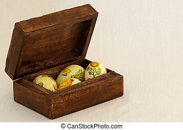 Easter eggs in a natural wooden box