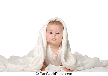 The baby under a towel. Age of 8 months. It is isolated on a white background