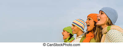 carol singers or carolers - group of happy carol singers,...