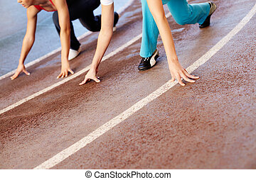 Race track - Close-up of race-track with sprinting athlete?s...