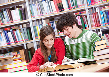 Reading books - Portrait of teenage girl reading book with...