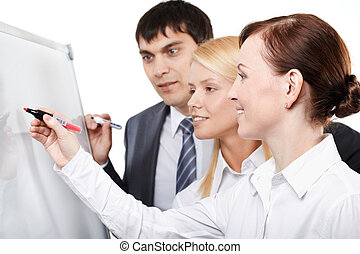 Business teamwork - Three businesspeople drawing something...