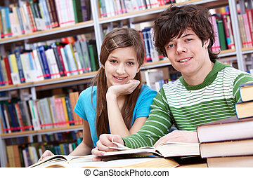 Reading classmates - Portrait of teenage girl and her...