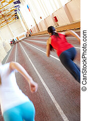 Competition - Gymnasium with blurred running silhouettes