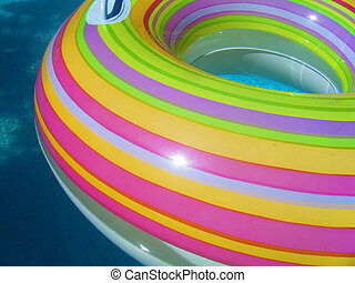 Colourful Inner tube in the Water