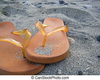 Orange Flip-Flops in Sand - Orange flip-flops in the sand