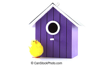 Bird house with bird on a white background.