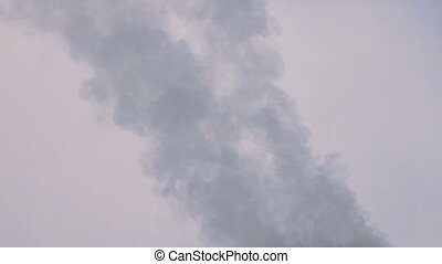Smoke close 3 - Tufts of smoke wafting from a smokestack or...