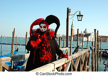 Harlequin mask near canal,carnival - Harlequin mask near...