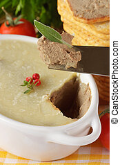 Pate close-ap - Pate on a knife with leaf of sade close-ap