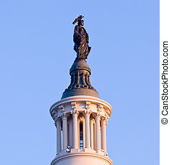 Sunrise behind the Statue of Freedom in DC