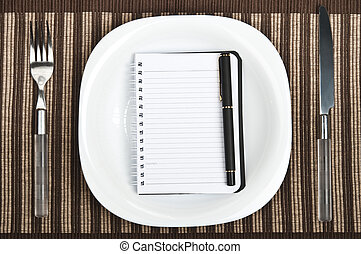 Notepad on food plate - Notepad on plate with fork and knife