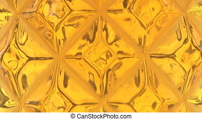 Faceted Beer Bubbles slow - A fine ale exhibiting the...