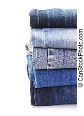 stack of blue jeans - stack of various shades of blue jeans...