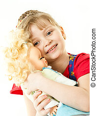 A girl with a doll - A cute girl rocking her doll to sleep...