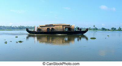 Tourism in Kerala India - A riverboat cruise on the...