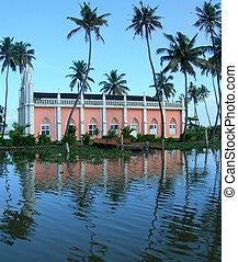 Tourism in Kerala India - Palm trees and churchon lagoon...