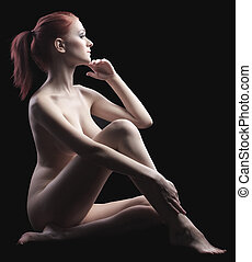 Beauty naked girl sit in dark - close her body - Young naked...