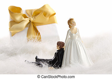 Wedding cake figurines with gift on white - Wedding cake...