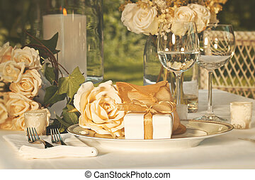 Wedding party favors on plate at reception - Gold wedding...