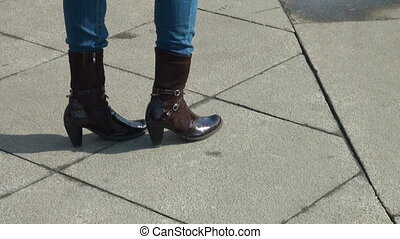 Female feet in boots