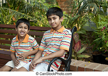Brothers - Two Indian brothers sitting happily at a local...