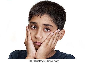 sad - An handsome Indian kid looking very sad