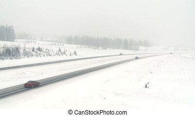 Highway snowstorm traffic 07 - Traffic on highway during a...