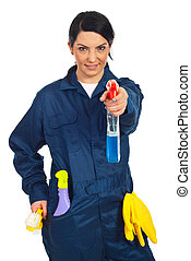 Cleaning worker woman holding spray bottle isolated on white...