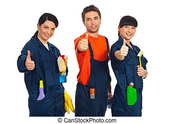 Cleaning workers giving thumbs up - Cleaning workers in a...