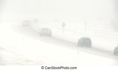 Highway snowstorm traffic 09 - Traffic on highway during a...