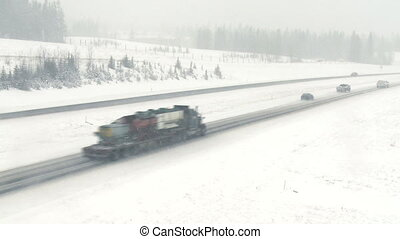 Truck in snowstorm 02 - Truck traffic on highway during a...