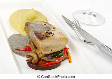 Main Dish: Mediterranean Tuna with mashed potato, gravy and vegetables on white plate with cutlery (Selective Focus)