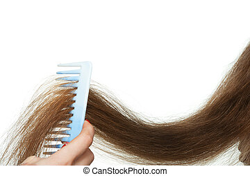 Hairbrush and long hair. It is isolated on a white...