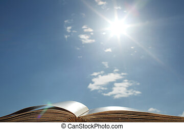 book of wisdom -  book of wisdom on sun sky background