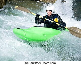 female kayaker - an active female kayaker on the rough water
