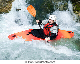 kayaker - an active kayaker on the rough water