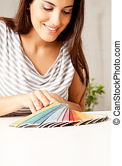 Woman looking at Color Swatches