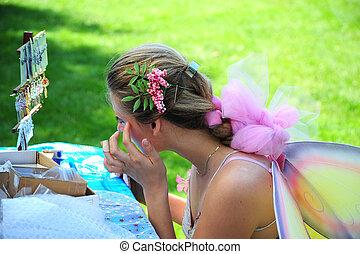 Fairyland - Female applying makeup in fairyland.