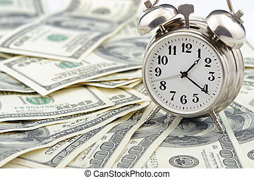 Time - money Business concept Analog hours on a heap of...