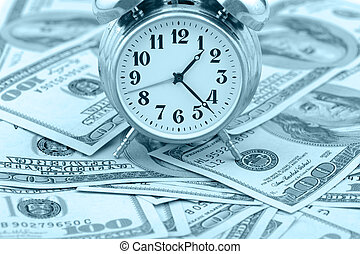 Time - money. Business concept. Analog hours on a heap of...