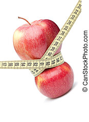 Closeup of a red apple with a measuring tape Isolated on...